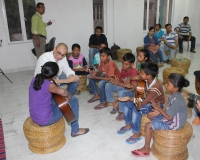 Amyt Datta with students of the Kalikapur Classical Guitar Centre